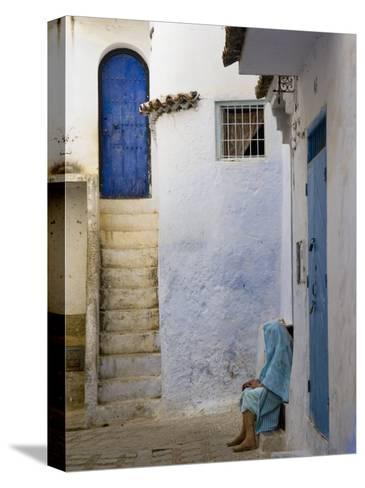 Street Scene in the Famous Blue Town of Chefchaouen-Annie Griffiths Belt-Stretched Canvas Print