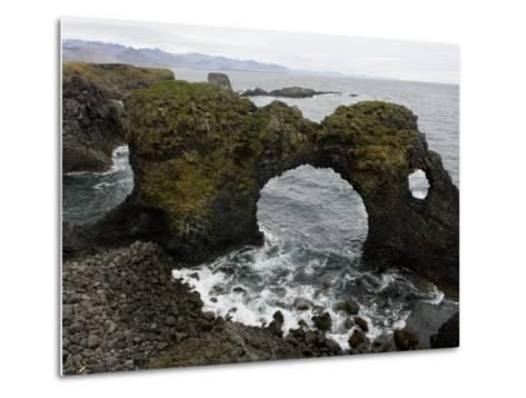Sea Pounds Volcanic Rock Along the Coast of Iceland-Annie Griffiths Belt-Metal Print