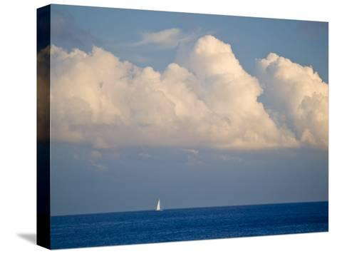 Lone Sailboat Sailing Along the Horizon in France-Michael Melford-Stretched Canvas Print