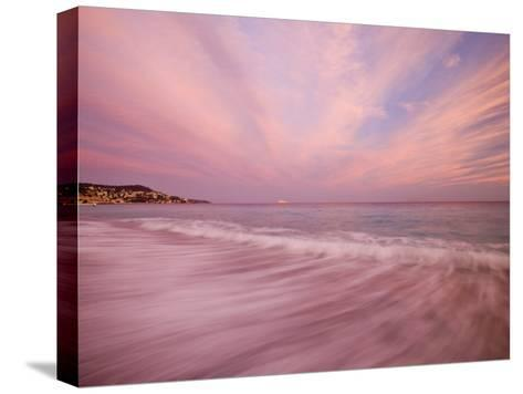 Sunset Creates a Pink Cast over the Surf in the South of France-Michael Melford-Stretched Canvas Print