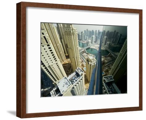 Cityscape of High Rises and Waterways in Downtown Dubai-Mattias Klum-Framed Art Print