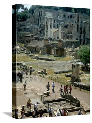 Tourists Walk Through Rome's Ancient Forum with Palatine Hill Behind-O^ Louis Mazzatenta-Stretched Canvas Print