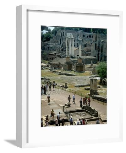 Tourists Walk Through Rome's Ancient Forum with Palatine Hill Behind-O^ Louis Mazzatenta-Framed Art Print