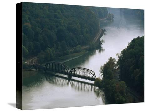 Railroad Bridge over the New River, and Tracks Running Along the Shore-Raymond Gehman-Stretched Canvas Print