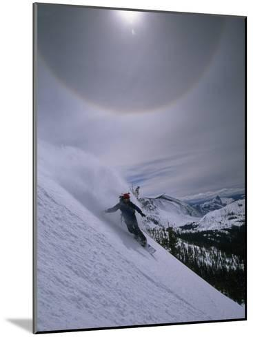 Snowboarding Down a Peak in Yosemite High Country-Bill Hatcher-Mounted Photographic Print
