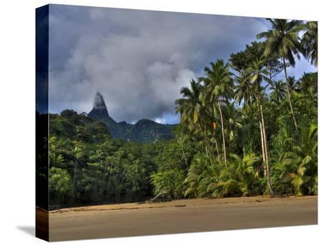 Volcanic Mountains and Palm Trees Along the Beach on Principe Island-Michael Polzia-Stretched Canvas Print