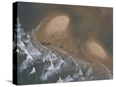 Waves Creating Patterns on a Tidal Beach-Michael Polzia-Stretched Canvas Print
