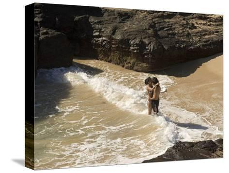 Couple Kissing in the Surf at Halona Beach on Oahu Island-Charles Kogod-Stretched Canvas Print
