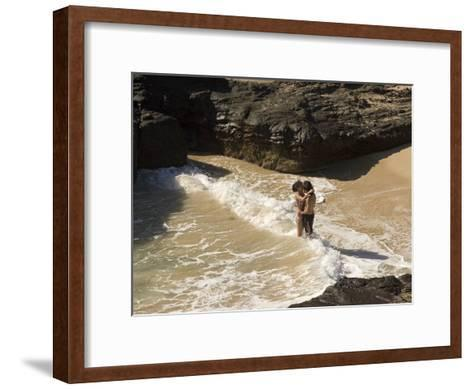 Couple Kissing in the Surf at Halona Beach on Oahu Island-Charles Kogod-Framed Art Print