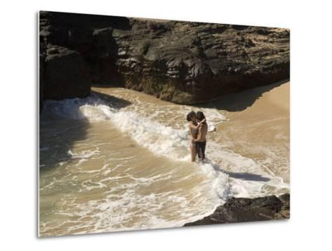 Couple Kissing in the Surf at Halona Beach on Oahu Island-Charles Kogod-Metal Print