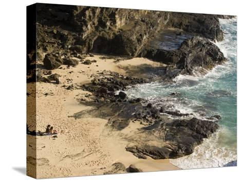 Couple Sunbathing in the Sands of Halona Beach on Oahu Island-Charles Kogod-Stretched Canvas Print