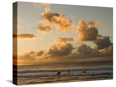 Two Surfers Enter the Pacific Ocean as the Sun Sets in Hawaii-Charles Kogod-Stretched Canvas Print