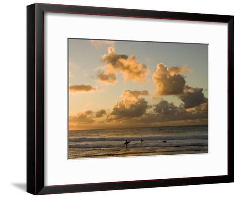 Two Surfers Enter the Pacific Ocean as the Sun Sets in Hawaii-Charles Kogod-Framed Art Print