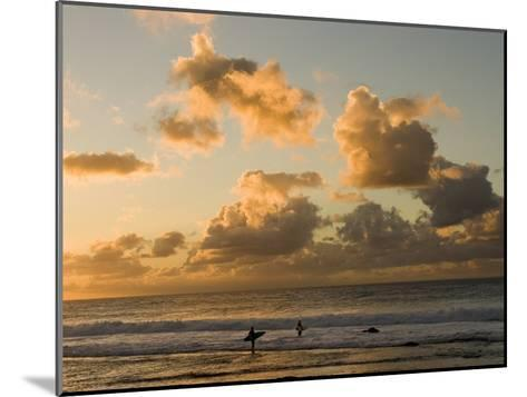 Two Surfers Enter the Pacific Ocean as the Sun Sets in Hawaii-Charles Kogod-Mounted Photographic Print