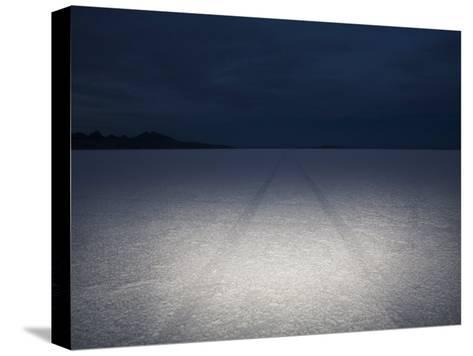 Vehicle Tracks Through the Bonneville Salt Flats, Utah at Night-John Burcham-Stretched Canvas Print