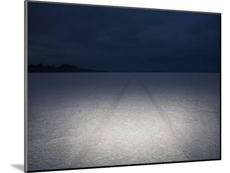 Vehicle Tracks Through the Bonneville Salt Flats, Utah at Night-John Burcham-Mounted Photographic Print