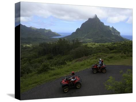 Tourists Riding All Terrain Vehicles on Moorea Island-Stephen Alvarez-Stretched Canvas Print
