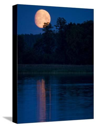 Moon Light Reflecting in Calm Lake Water-Mattias Klum-Stretched Canvas Print