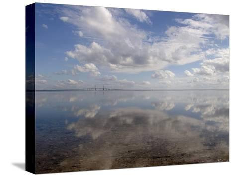 Cloud Reflections in Calm Water with the Sunshine Skyway Bridge-Skip Brown-Stretched Canvas Print