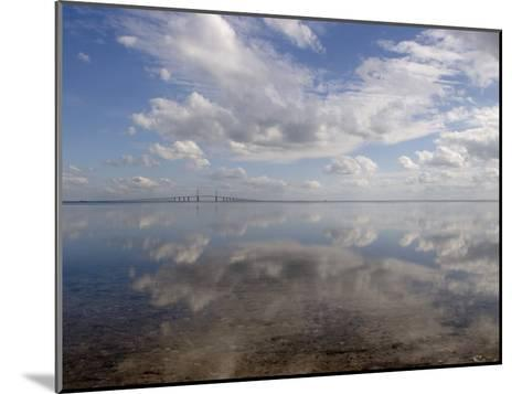 Cloud Reflections in Calm Water with the Sunshine Skyway Bridge-Skip Brown-Mounted Photographic Print