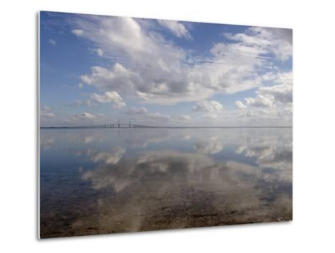 Cloud Reflections in Calm Water with the Sunshine Skyway Bridge-Skip Brown-Metal Print