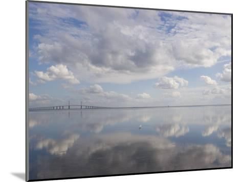 Clouds and Sky are Reflected in Calm Water with Bridge-Skip Brown-Mounted Photographic Print