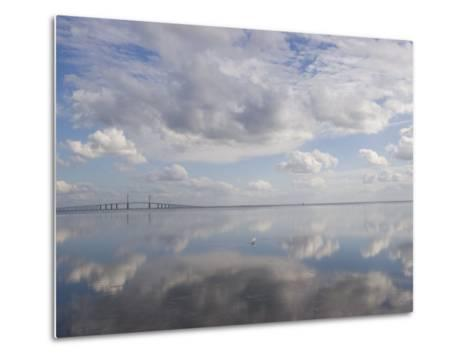 Clouds and Sky are Reflected in Calm Water with Bridge-Skip Brown-Metal Print