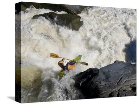 Kayaker Paddles Off a Waterfall into Big Whitewater-Skip Brown-Stretched Canvas Print
