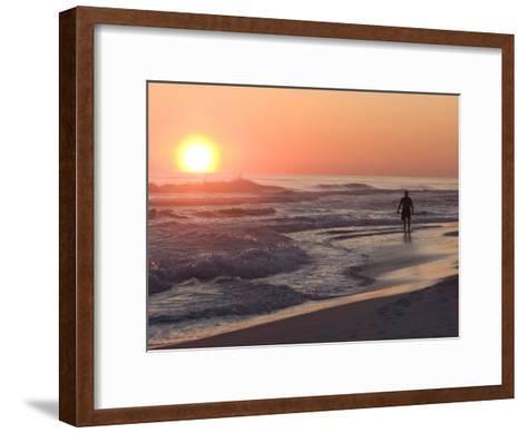 Silhouetted Man Walking Along the Beach at Sunset-Marc Moritsch-Framed Art Print