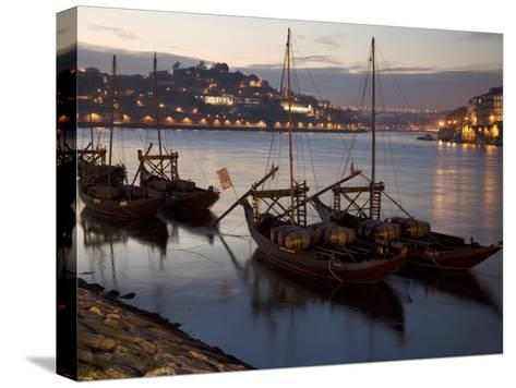 Wine Barrels on Boats in Oporto at Dusk-Michael Melford-Stretched Canvas Print