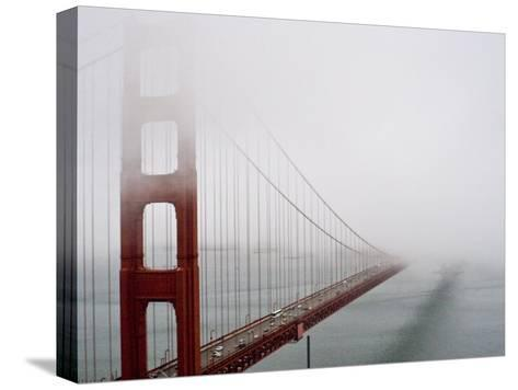 Fog Surrounds the Golden Gate Bridge Early in the Morning-Hannele Lahti-Stretched Canvas Print