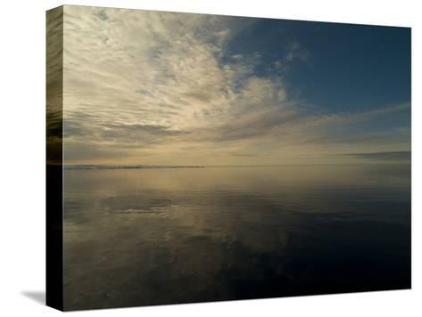 Serene View of Still Water under the Arctic Sky-Norbert Rosing-Stretched Canvas Print