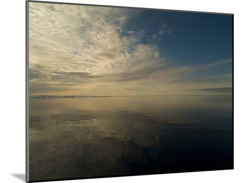 Serene View of Still Water under the Arctic Sky-Norbert Rosing-Mounted Photographic Print