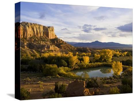 Pond Is Seen Next to Kitchen Mesa with Pedernal Peak in the Distance-Ralph Lee Hopkins-Stretched Canvas Print
