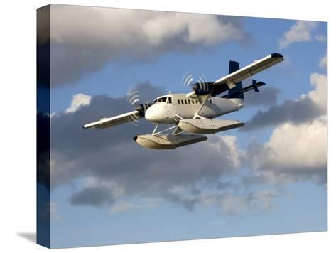 Sea Plane Flies Amid the Clouds-Pete Ryan-Stretched Canvas Print