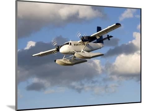 Sea Plane Flies Amid the Clouds-Pete Ryan-Mounted Photographic Print