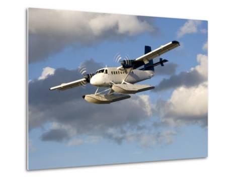 Sea Plane Flies Amid the Clouds-Pete Ryan-Metal Print