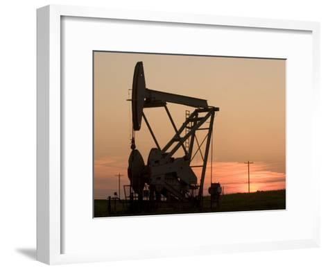 Oil Drilling Pump Silhouetted Against the Sunset in North Dakota-Phil Schermeister-Framed Art Print