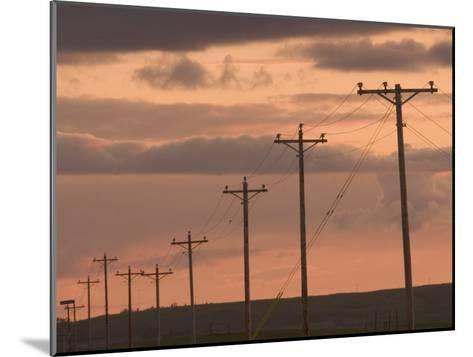 Row of Telephone Poles at Sunset in Rural North Dakota-Phil Schermeister-Mounted Photographic Print