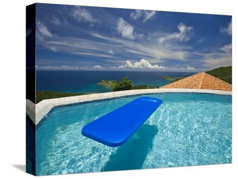 Blue Raft Floats in a Pool Overlooking the Caribbean Sea-Michael Melford-Stretched Canvas Print