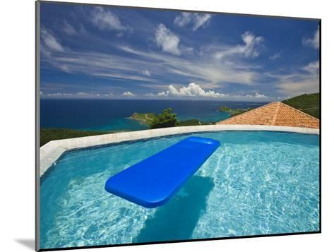 Blue Raft Floats in a Pool Overlooking the Caribbean Sea-Michael Melford-Mounted Photographic Print