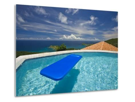 Blue Raft Floats in a Pool Overlooking the Caribbean Sea-Michael Melford-Metal Print