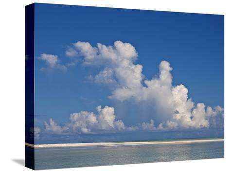 View of a White Beach, Ocean and Sky in the Seychelles-Michael Melford-Stretched Canvas Print