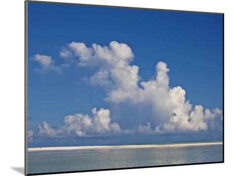 View of a White Beach, Ocean and Sky in the Seychelles-Michael Melford-Mounted Photographic Print