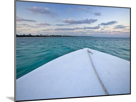 Bow of a Boat Sails Toward a Tropical Sunset-Michael Melford-Mounted Photographic Print