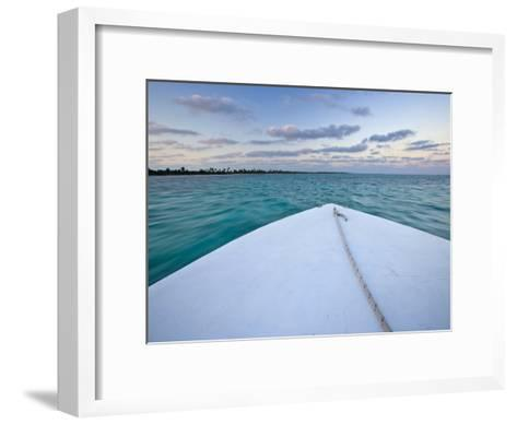 Bow of a Boat Sails Toward a Tropical Sunset-Michael Melford-Framed Art Print