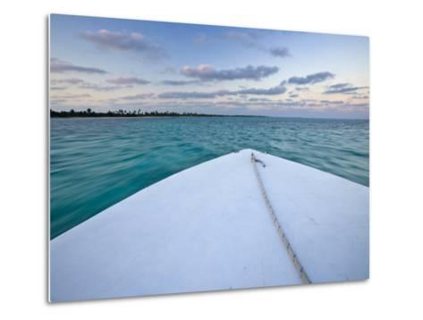 Bow of a Boat Sails Toward a Tropical Sunset-Michael Melford-Metal Print