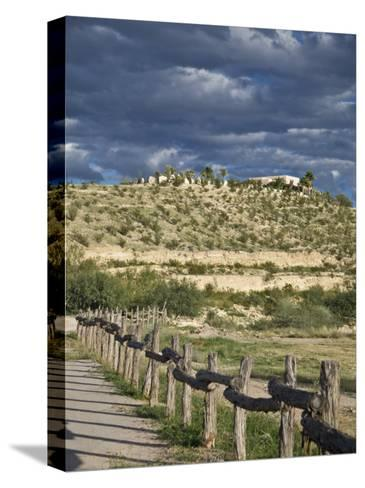 Texas, Western Themed Brewster County. Log Fence in Desert-Richard Nowitz-Stretched Canvas Print