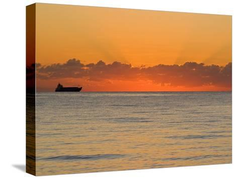Silhouetted Ship Moments before the Sun Rises over the Horizon-Mike Theiss-Stretched Canvas Print