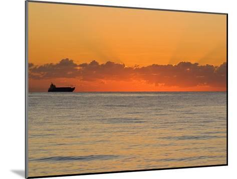 Silhouetted Ship Moments before the Sun Rises over the Horizon-Mike Theiss-Mounted Photographic Print